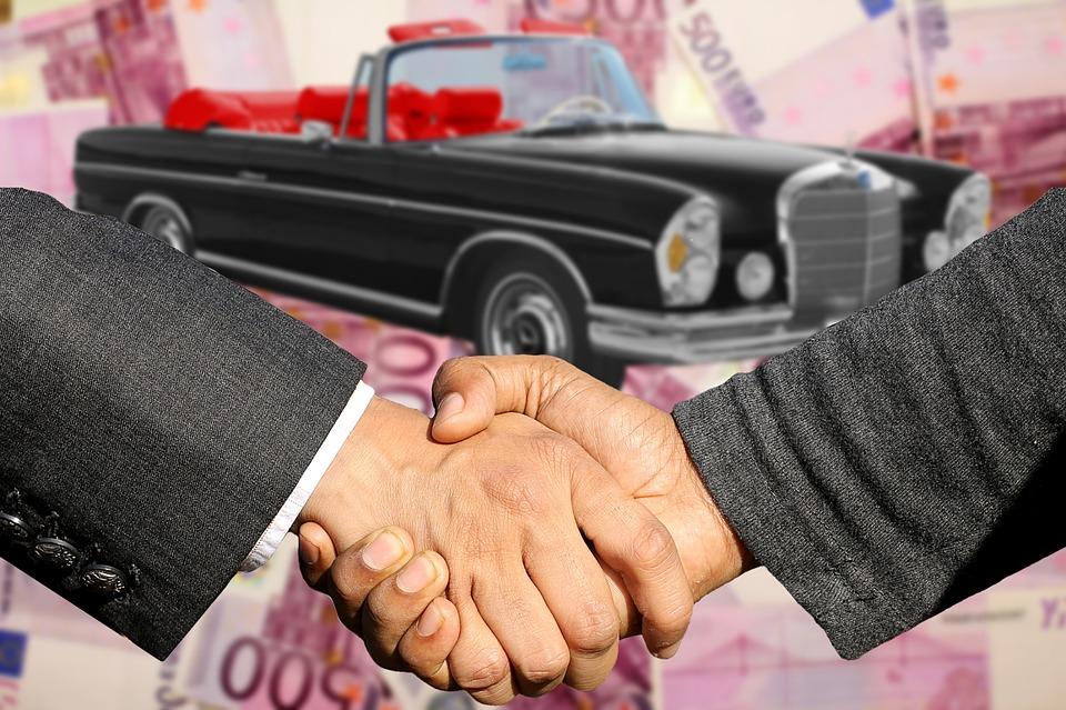 Kättely autokaupan merkiksi